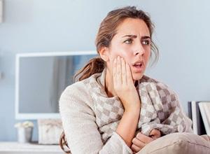 dente do juízo nascendo sintomas