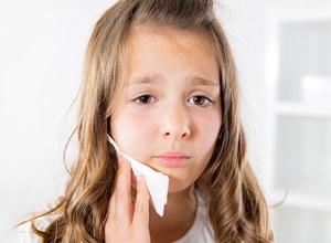 dente extraído doendo